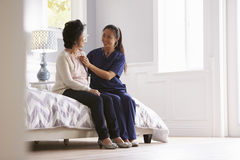 Nurse Making Home Visit To Senior Woman For Medical Exam Royalty Free Stock Images