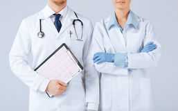 Nurse and male doctor holding cardiogram Stock Photos