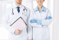 Nurse and male doctor holding cardiogram Royalty Free Stock Photos