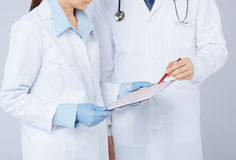 Nurse and male doctor holding cardiogram Royalty Free Stock Image