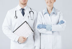 Nurse and male doctor holding cardiogram Royalty Free Stock Photo