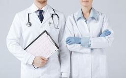 Nurse and male doctor holding cardiogram Stock Photo