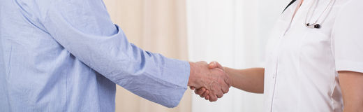 Nurse and man handshake Royalty Free Stock Images