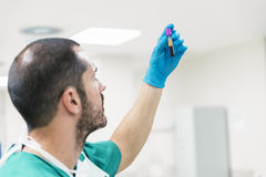 Nurse man holding blood in test tube. Royalty Free Stock Images