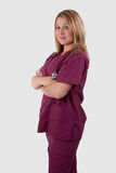 Nurse in maroon Scrubs Stock Photos