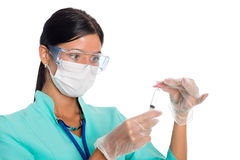 Nurse in a mask prepares a syringe Stock Image