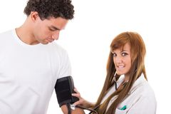Nurse measures the blood pressure of a patient Stock Image