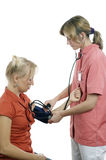 Nurse measures pressure at the patient Stock Photo
