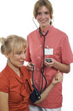 Nurse measures pressure at the patient Stock Images