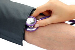Nurse measuring the blood pressure Stock Image