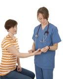 Nurse measuring patient's pulse Stock Images