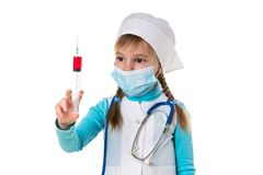 Nurse with medical face mask, looking at the syringe with a red liquid, on white landscape background.  stock image