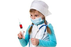 Nurse with medical face mask and a syringe with a red substance, landscape.  royalty free stock images