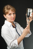 A nurse in a medical gown gaining a syringe Royalty Free Stock Photo