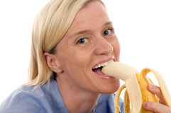 Nurse medical person eating banana Stock Photography