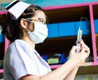 Nurse with medical syringe Stock Photo