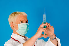 Nurse with medical syringe Royalty Free Stock Images