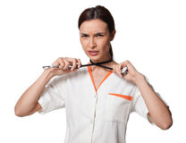 Nurse or medicine student hanging with the stethoscope. Creative photo of a nurse or medicine student hanging herself with the stethoscope; beautiful young Royalty Free Stock Photo