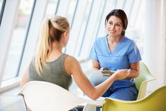 Nurse Meeting With Teenage Girl In Modern Hospital Royalty Free Stock Image