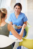 Nurse Meeting With Teenage Girl In Modern Hospital Stock Photos