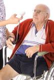 Nurse monitoring blood pressure Stock Images