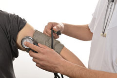 Nurse monitoring blood pressure Stock Photography