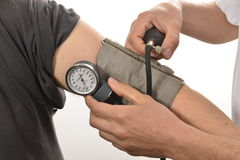 Nurse monitoring blood pressure Royalty Free Stock Image