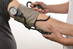 Nurse monitoring blood pressure Stock Image