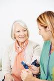 Nurse monitoring blood pressure Royalty Free Stock Photos