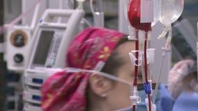 Nurse monitors IV equipment stock footage