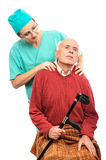 Nurse old disabled man massage Royalty Free Stock Image