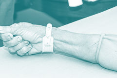 A nurse open intravenous fluid patient for injection Royalty Free Stock Images