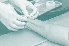 A nurse open intravenous fluid patient for injection Stock Photo