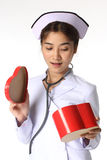 Nurse opening a chocolate box Stock Image