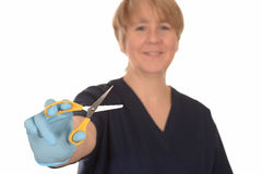 Nurse with pair of scissors Royalty Free Stock Photo
