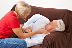 Nurse and patient. Health care provider checks for pulse on cardiac artery stock photography