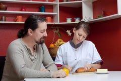 Nurse and patient in conversation Stock Photos