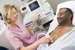 Nurse With Patient Having Ultrasound Scan Royalty Free Stock Photos