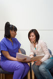Nurse and patient looking at file Royalty Free Stock Image