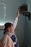 Nurse and patient monitor Stock Image