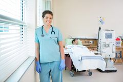 Nurse With Patient Receiving Renal Dialysis In Royalty Free Stock Photography