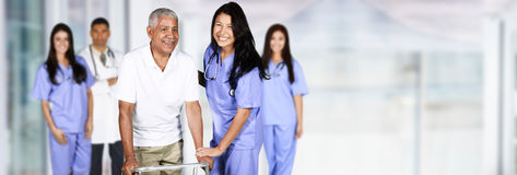 Nurse and Patient. Nurse taking care of an elderly patient Royalty Free Stock Image