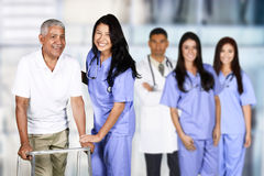Nurse and Patient. Nurse taking care of an elderly patient Royalty Free Stock Images