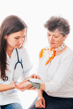Nurse and patient with tensiometer royalty free stock photo