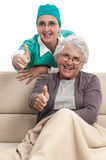 Nurse and patient thumb up Stock Images