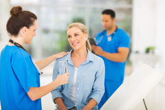 Nurse patient water Stock Photography