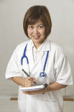 Nurse with patients records Stock Images