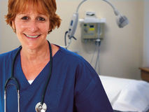 Nurse In Patients Room. Older Nurse Standing In Patient's Room Stock Image