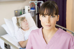 Nurse In Patients Room Royalty Free Stock Images
