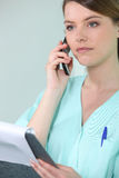 Nurse on the phone Royalty Free Stock Photos